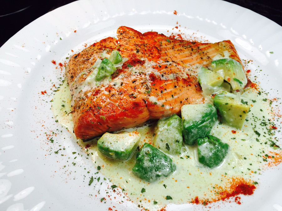 Butter cream sauce and avocado over salmon